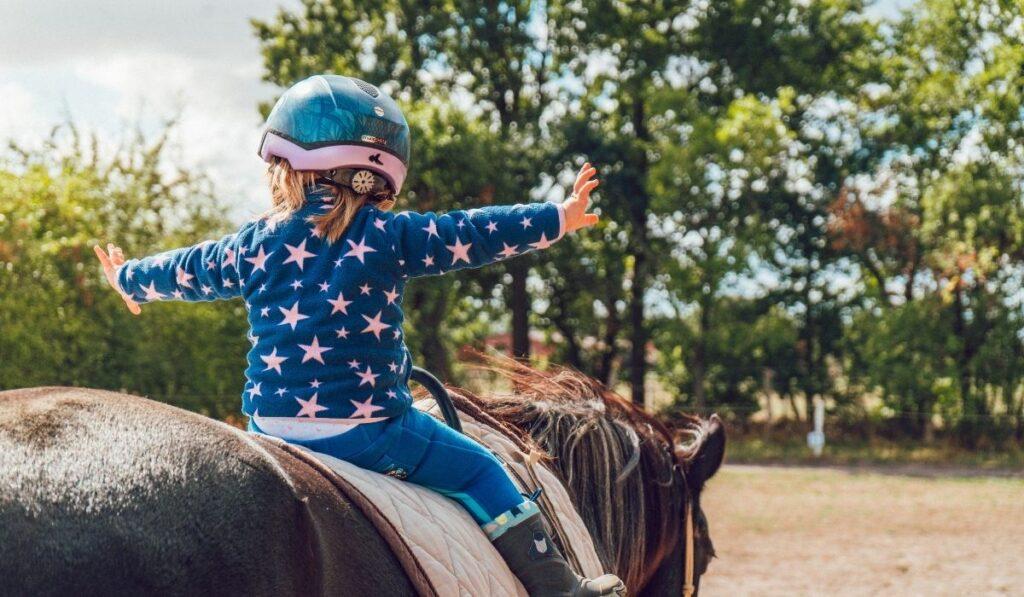 Kid Riding Horse with Helmet